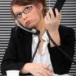 Foto de Stock  : Secretary overwhelmed with two phones