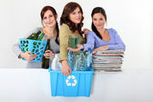 Young women taking out the recycling — Stock Photo