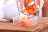 Carrots sliced in a mini food processor — Stock Photo