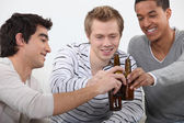 Three friends getting drunk together — Stock Photo