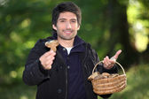 Man picking mushrooms — Stock Photo