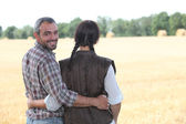 Farmers in a field — Stock Photo