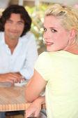 Man and woman enjoying coffee on terrace — Stock Photo