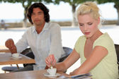 Man and woman having coffee on a terrace — Stock Photo