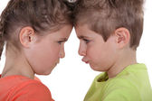Kids pouting face to face — Stock Photo