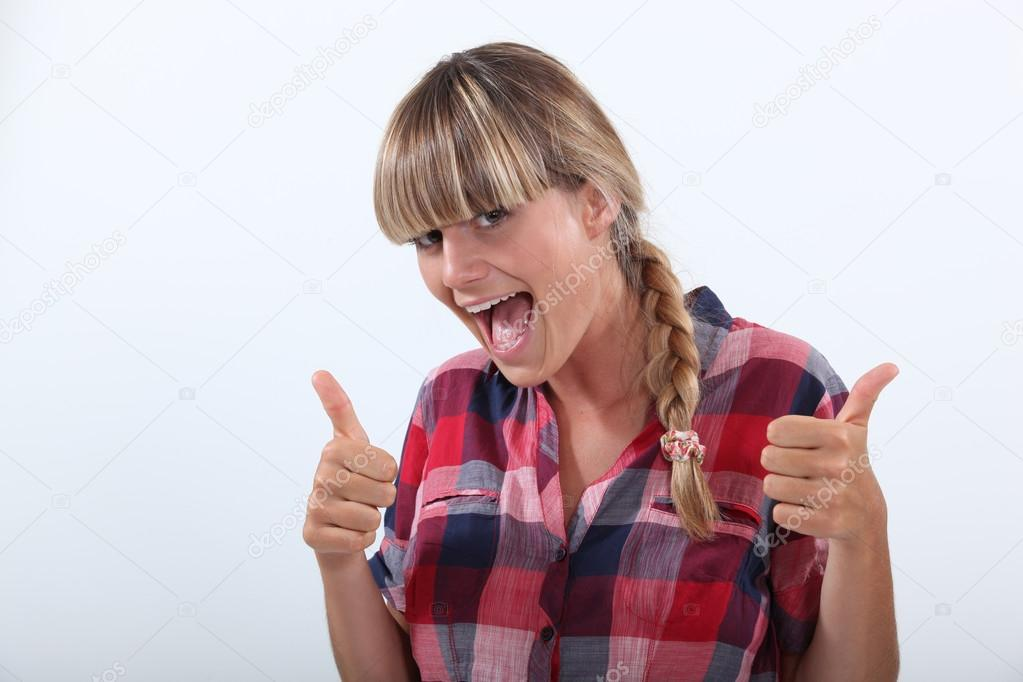 Teen girl, thumbs up — Stock Photo #14568017