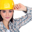 Woman touching the brim of her hard hat — Stock Photo
