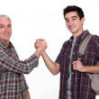 Experienced handyman greeting new starter — Stock Photo #14572259