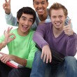 Stock Photo: Three teenagers grimacing