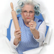 Angry old woman with a rolling pin — Stock Photo