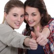 Young women giving the thumb — Stock Photo #14573075