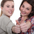 Two teenage girls giving the thumbs-up — Stock Photo