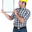 Stock Photo: Man holding empty picture frame
