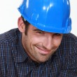 Foto Stock: Shy male builder