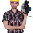 Stock Photo: Mholding hand-held cold saw