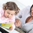 Mum and daughter reading together — Stock Photo #14579685