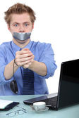Man with mouth taped up — Stock Photo