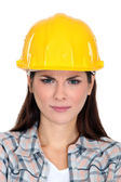 An unsatisfied female construction worker. — Stock Photo
