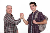 Experienced handyman greeting new starter — Stock Photo