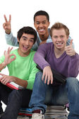 Three teenagers grimacing — Stock Photo
