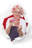 Old fashioned woman wearing hair rollers — Stock Photo