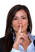Businesswoman gesturing for silence — Stock Photo