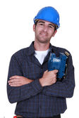 Man holding electric sander — Stockfoto