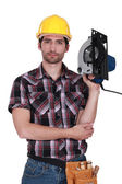 Man holding a hand-held cold saw — Stock Photo