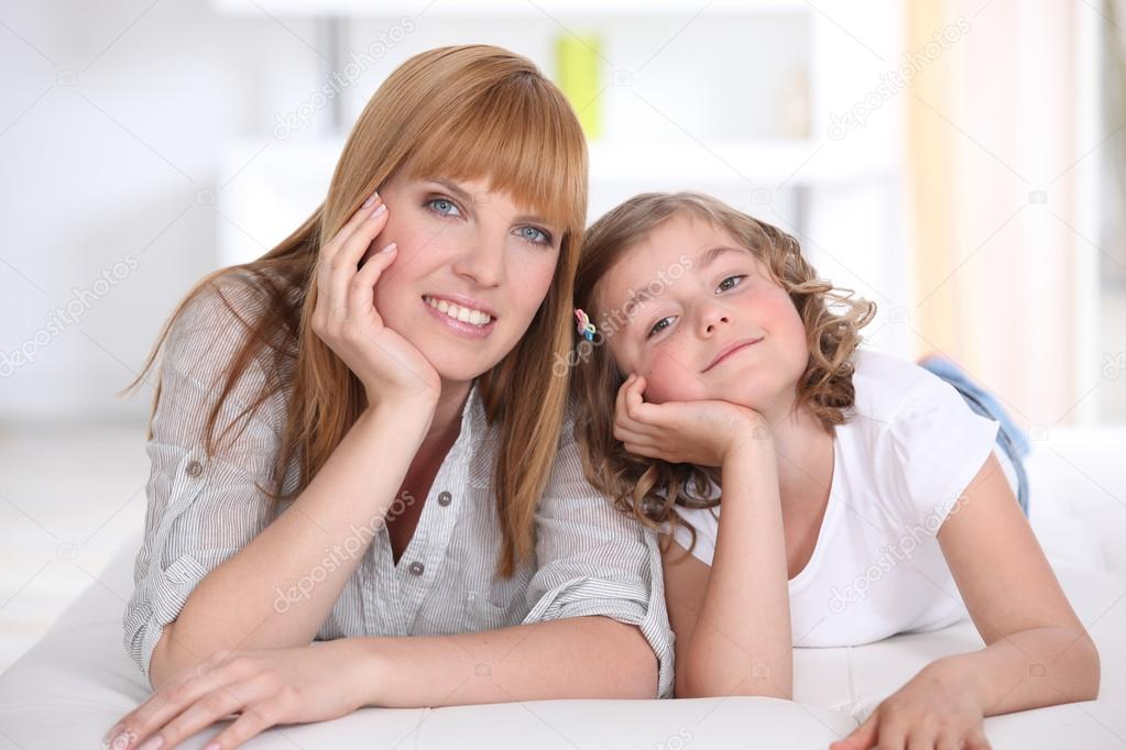 Mother and daughter at home — Stock Photo #14579473