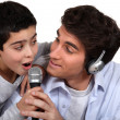 Stock Photo: Father and son singing