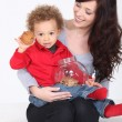 Stock Photo: Mother and Child with cookie jar