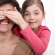 Daughter putting her hands before mother — Stock Photo