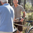 Grey haired man on bike ride — Stock Photo