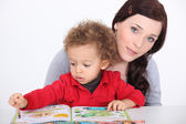 Mother and son reading book together — Stock Photo