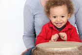 Little boy sat by bongo drum — Stock Photo