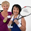 Two senior women playing tennis — Stock Photo #14591343