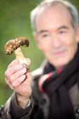 Man with Mushroom — Stock Photo