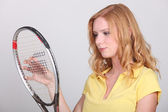 Young woman holding tennis racquet — Stock Photo