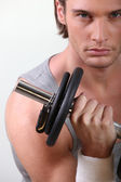 Blonde man doing fitness with dumbbell — Stock Photo