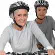 Elderly couple riding bikes — Stock Photo #14611303
