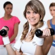 Young woman working out at the gym — Stock Photo