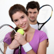 Stock Photo: Young couple with tennis racquets