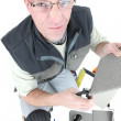 Man cutting a tile — Stock Photo