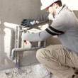 Foto Stock: Plumber at work outdoors