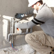 Stock Photo: Plumber at work outdoors