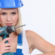 Blond female builder holding cordless drill — Stock Photo #14635243