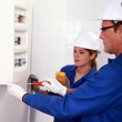 Electricians with electrical panel — Stock Photo