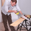 Carpenter using a handsaw — Foto de Stock