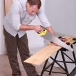 Carpenter using a handsaw — Stock fotografie