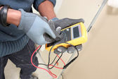 Close-up of electrician using voltmeter — Stock Photo